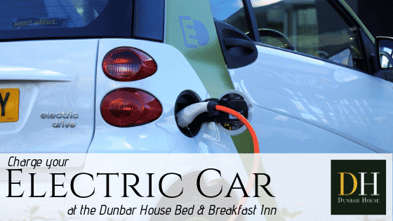 Dunbar House promotional image: Charge your Electric Car at the Dunbar House with image of electric car hooked up to charging station.