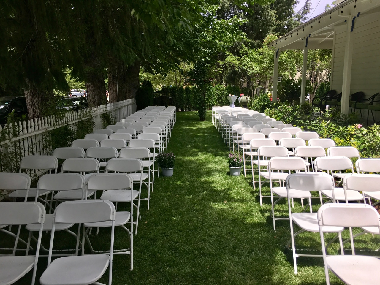 white chairs in green lawn garden