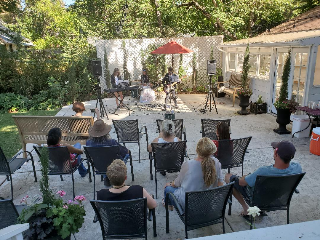 girl rock band plays for intimate audience
